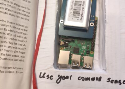 Raspberry pi and power source hidden in book